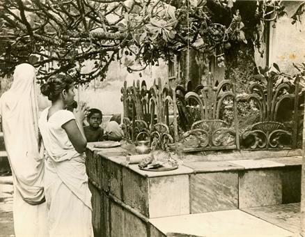 Hindu Women Praying shiva Shrine